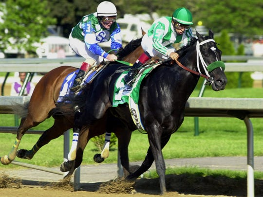 War Emblem running to victory in the 2002 Haskell Invitational at Monmouth Park.