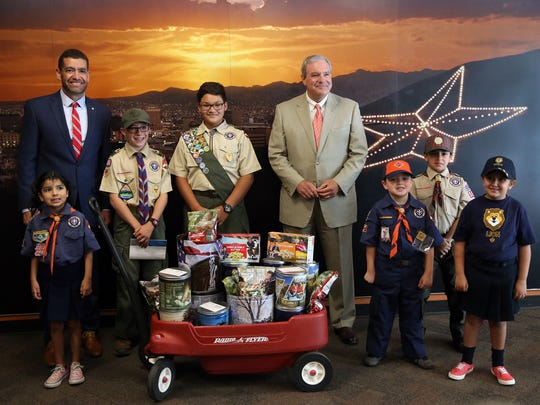Cub and Boy Scouts pose with their popcorn and El Paso Mayor Dee Margo, right, and Mario Perez, Scout executive and CEO of the Boy Scouts of America Yucca Council, on Monday at City Hall.