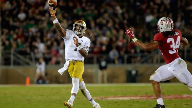 Nov 25, 2017; Stanford, CA, USA; Notre Dame Fighting Irish quarterback Brandon Wimbush (7) throws the football against Stanford Cardinal linebacker Peter Kalambayi (34) during the second quarter at Stanford Stadium. Mandatory Credit: Sergio Estrada-USA TODAY Sports