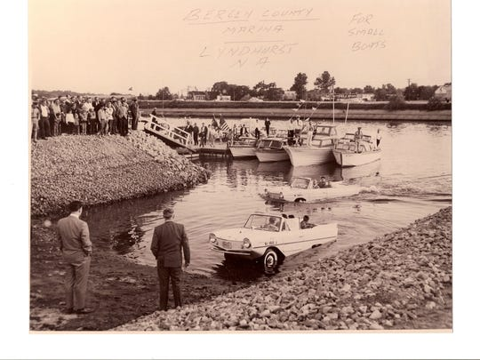 Amphicars are featured in this photo from the 1960s when the part vehicle/part boat designs floated up to a dock in Lyndhurst before driving off.