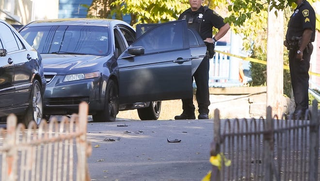 Police investigate a shooting on Merrimac Street in Evanston Monday. One man was shot in the chest and arms. He is expected to survive.