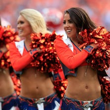 DENVER, CO - SEPTEMBER 14:  Denver Broncos cheerleaders perform during a game between the Denver Broncos and the Kansas City Chiefs at Sports Authority Field at Mile High on September 14, 2014 in Denver, Colorado.  (Photo by Doug Pensinger/Getty Images)