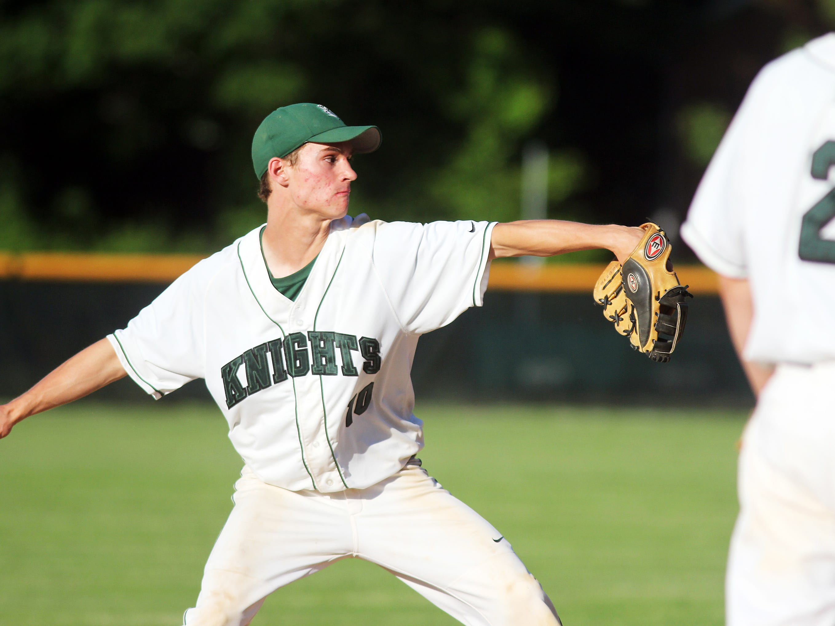 Rice's Tommy Fitzgerald throws to first base in a playoff game against Rutland.