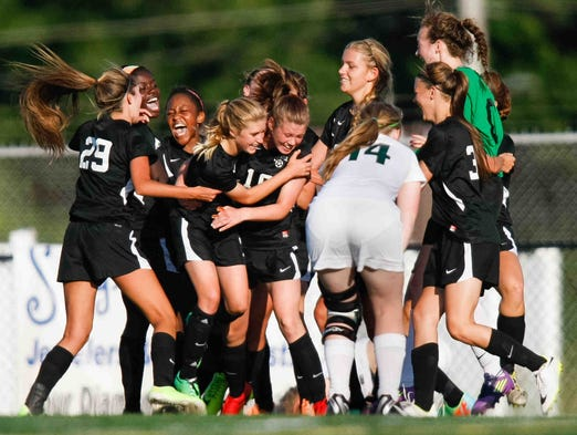 Caravel celebrates as they beat Archmere with a final score of 2-1 for the Division II DIAA Girls State Championship Monday June 2, 2014 at Smyrna High School.