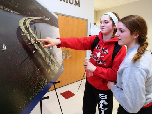 Megan Smith of Blauvelt, left, and Rachel Maggiore of Orangeburg look at a rendering of the new bridge at a public meeting on the Tappan Zee Bridge project at Sleepy Hollow High School March 25, 2014. Project leaders shared the latest information on project.