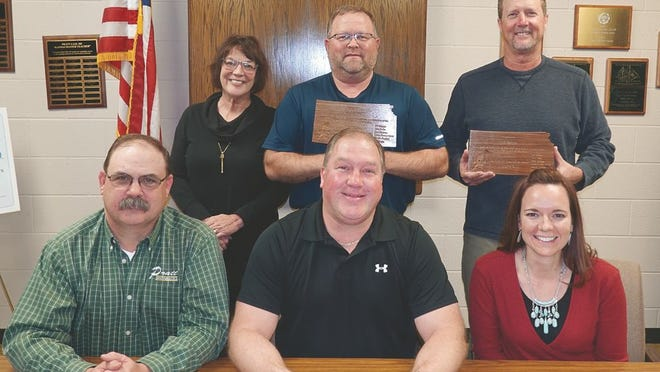Pratt USD 382 board of education members acknowledged outgoing members Bill Skaggs and Brian Schrag (back row, from right) at their December 9, 2019 meeting.