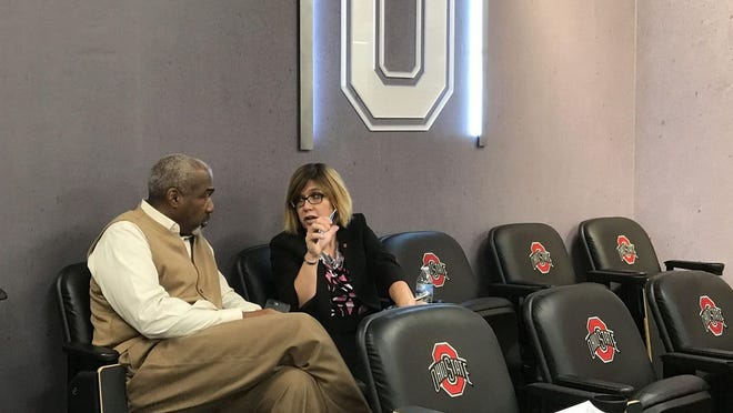 Ohio State athletic director Gene Smith, left, talks with Diana Sabau, Ohio State's senior associate athletics director and football administrator, at a 2017 news conference. Sabau might follow the path of other assistants under Smith who have landed athletic director positions at a Power Five conference school.
