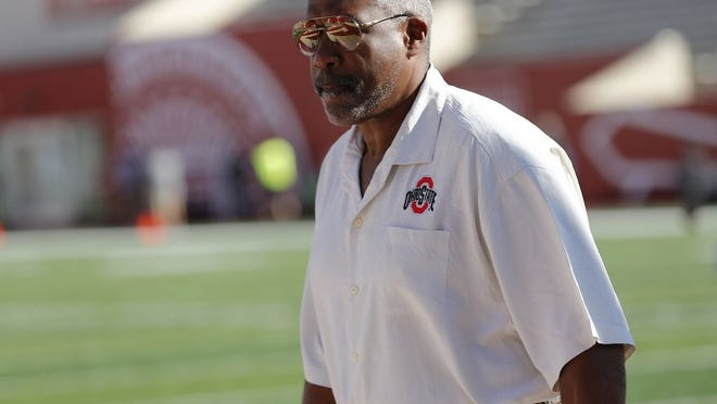 Ohio State Athletic Director Gene Smith walks across the field prior to the NCAA football game against the Indiana Hoosiers at Memorial Stadium in Bloomington, Ind. on Saturday, Sept. 14, 2019.