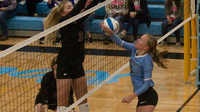 L/E/M senior middle hitter Lexis Olson blocks a Rocket shot in a game against New Rockford-Sheyenne on Oct. 20 at New Rockford-Sheyenne School. The Cardinals won 3-0.