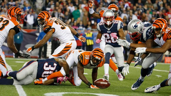 New England Patriots running back Brandon Bolden (38) forces a fumble on the Cincinnati Bengals wide receiver Brandon Tate (19) on a kickoff return in the third quarter at Gillette Stadium. The Enquirer/Jeff Swinger