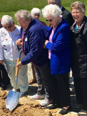 Patricia Yetter, a resident at Quincy Village, shovels dirt at the groundbreaking ceremony for Parker House Assisted Living the afternoon of May 16. Other residents participated as well.