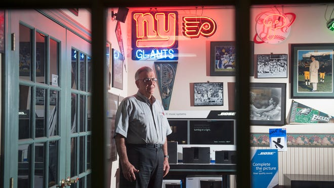 Anthony Del Ricci, owner of Camera & TV Stop, stands in front of his Medford store, which will close by the end of the month. Technology proved to be his downfall.