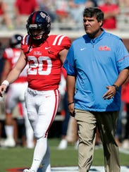 Mississippi quarterback Shea Patterson (20) walks with