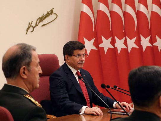 Turkish Prime Minister Ahmet Davutoglu, center, and
