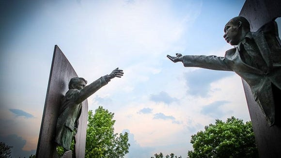 The Landmark for Peace memorial in Indianapolis depicts Martin Luther King Jr. and Robert F. Kennedy with outstretched arms.