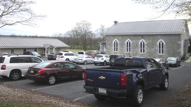 Members of Salem Church park their cars in the parking lot for a 'drive-in' style church service. PROVIDED PHOTO