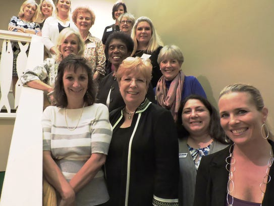 Several previous Women of Distinction winners gather