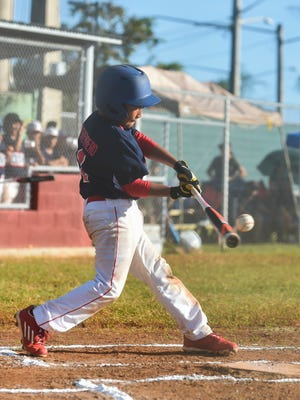 In this file photo from January 2017, Guam's Rick Leon Guerrero makes contact with a pitch during the U12 Oceania Baseball Championship Tournament against Austrailia at the Jose C. Guerrero Stadium in Hagåtña on Jan. 14, 2017.
