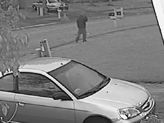 One of two surveillance photos of a person suspected of killing Amanda Blackburn released by IMPD.
