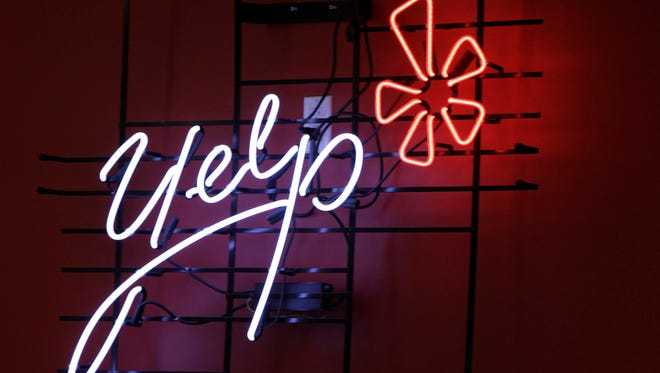 This 2011 file photo shows the logo of the online review website Yelp on a wall at the company's New York offices.