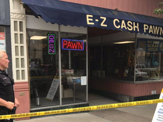 E-Z Cash Pawn's owner shot an alleged robber Wednesday,
