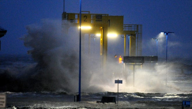 Waves lash against the ferry pier on the North Sea coast in Dagebuell,? Germany, on Dec. 5.