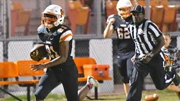 MTCS running back Kemari McGowan sprints down the sideline in route to one of his many touchdowns on Friday, Sept. 29, 2017.