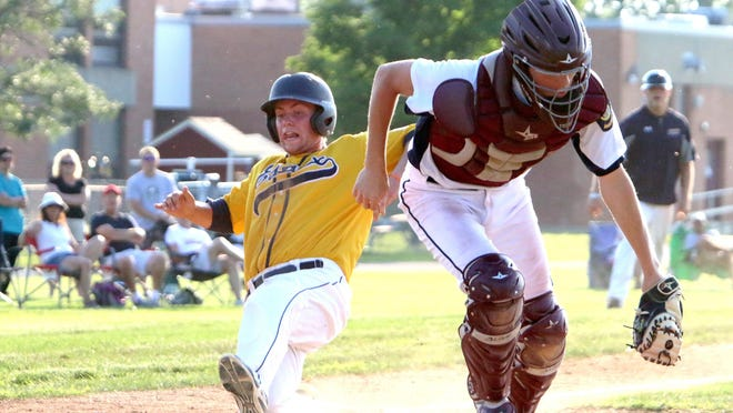Jake Gaboriault slides safely into home during Essex Legion Post 91's game against Franklin County.