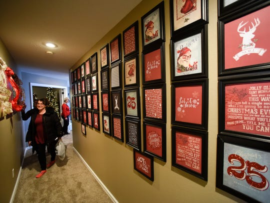 People tour the decorated rooms of the annual Zonta