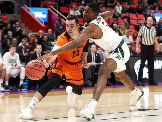 Michigan State's Jaren Jackson Jr., right, attempts