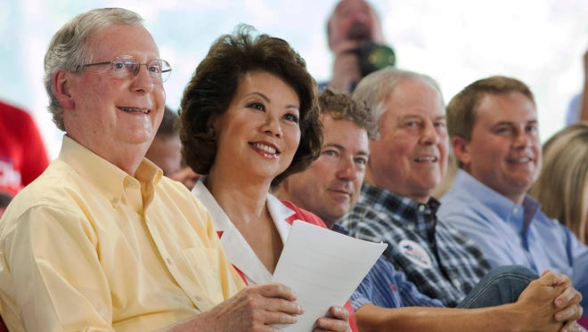 (From left:) U.S. Sen. Mitch McConnell, former U.S. Secretary of Labor (and McConnell's wife) Elaine Chao, U.S. Sen. Rand Paul, Rep. Ed Whitfield and Kentucky Department of Agriculture James Comer listen to Gov. Steve Beshear speak during the 134th Fancy Farm Picnic on Saturday.