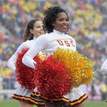 Spirited college football cheerleaders in 2016