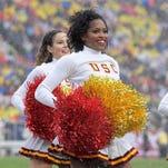 Spirited college football cheerleaders in 2016