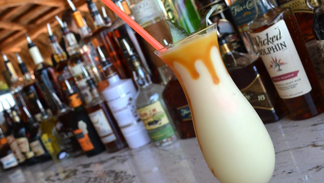 Enjoy a classic frozen rum drink at the Kane tiki bar on the beach at JW Marriott Marco Island.