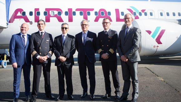Air Italy officials and crew pose with the airline's