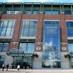 The Green Bay Packers cut the ribbon on the new American Family Insurance Gate and the new Lombardi Trophy replica at Lambeau Field, Thursday, November 13, 2014.