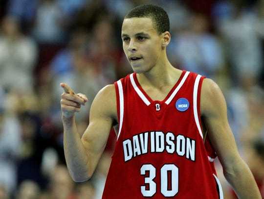Stephen Curry of Davidson points to his teammate after