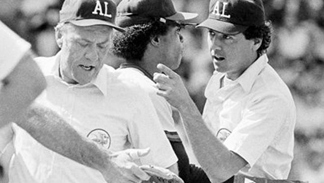 FILE - In this July 11, 1983, file photo, American League umpire Steve Palermo, right, is restrained by California Angels' Rod Carew after he and Angels' Bobby Grich got into an argument in Boston. Former big league umpire Palermo, whose accomplished career ended when he was shot trying to break up a robbery in 1991, has died. He was 67. (AP Photo/File)