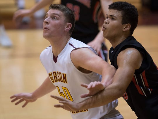 Gibson Southern's Wes Obermeier (40) is guarded by Southridge's Jaden Hayes (50) during their game at Gibson Southern Thursday night. The Raiders beat the Titans 59-57.