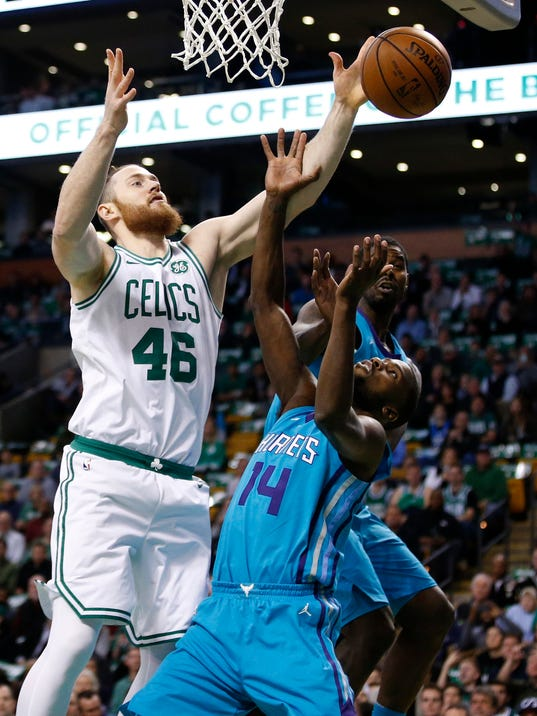 Boston Celtics' Aron Baynes (46) and Charlotte Hornets' Michael Kidd-Gilchrist (14) battle for a rebound during the first quarter of an NBA basketball game in Boston, Friday, Nov. 10, 2017. (AP Photo/Michael Dwyer)
