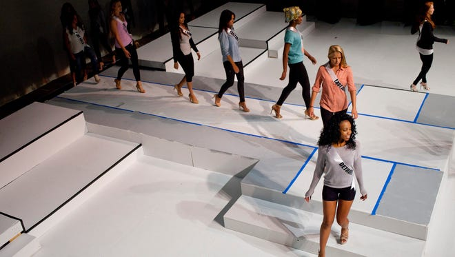 Contestants walk on the runway during rehearsal for Miss Michigan USA Friday at McMorran Theater in downtown Port Huron.