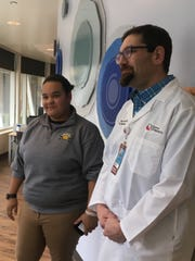 Alex Voland, left, speaks with her son's doctor, Josh Schaffzin, at Cincinnati Children's Hospital Medical Center about acute flaccid myelitis. Voland's 4-year-old son, Elijah, has been at Children's Hospital since mid-October being treated for what Schaffzin says is the strange, rare paralysis disorder.