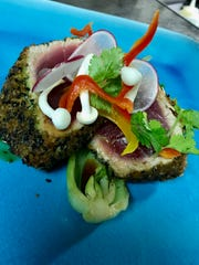 Wasabi crusted yellow fin tuna at Pompan Grill is served