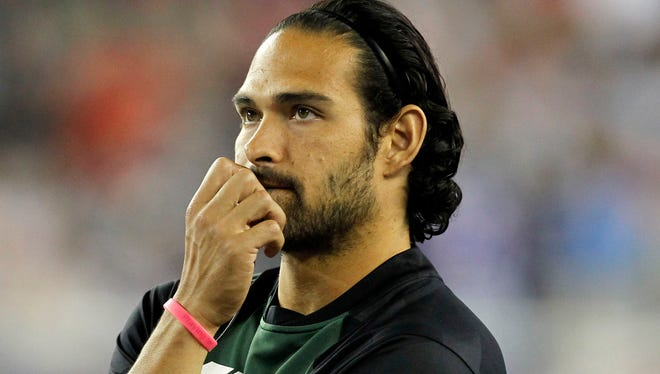 New York Jets quarterback Mark Sanchez (6) on the sidelines during the game against the New England Patriots at Gillette Stadium.