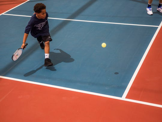 Javonne Wilder, 11, plays a practice match with the
