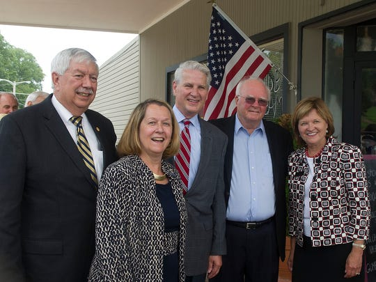 Oak Ridge Mayor Tom Beehan, left with Tennessee Supreme Court Justice Cornelia Clark, next to left, Chief Justice Gary Wade, center, retired Supreme Court Chief Justice, Riley Anderson, next to right, Justice Sharon Lee, right at a gathering of voters in Jackson Square, in Oak Kridge, Thursday, July 31, 2014.