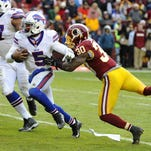 Buffalo Bills quarterback Tyrod Taylor (5) carries the ball for a 2-point conversion as Washington Redskins strong safety Kyshoen Jarrett (30) defends during the second half at FedEx Field.