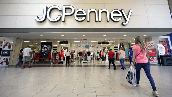 In this Wednesday, June 7, 2017, photo, shoppers walk into a J.C. Penney department store in Hialeah, Fla. On Wednesday, June 14, 2017, the Labor Department reports on U.S. consumer prices for May.