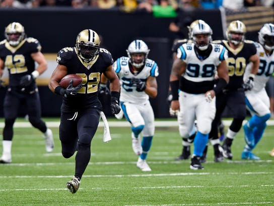 New Orleans Saints running back Mark Ingram (22) carries on a 72-yard run in the first half of an NFL football game against the Carolina Panthers in New Orleans, Sunday, Dec. 3, 2017. (AP Photo/Bill Feig)