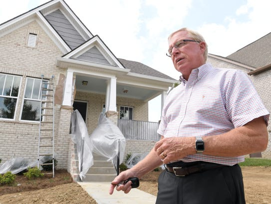 David McGowan, owner of Regent Homes, walk through